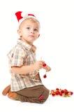 Little boy wearing a Santa hat Stock Photography