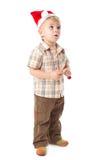 Little boy wearing a Santa hat Royalty Free Stock Photos