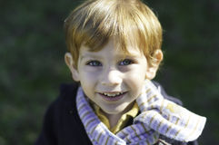 Little boy wearing a scarf Stock Images