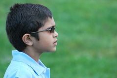 A little boy wearing sunglasses outdoor background Royalty Free Stock Photo