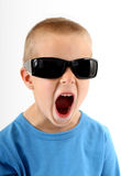 Little boy wearing sunglasses and singing Royalty Free Stock Photos