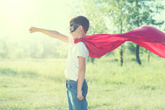 Little boy wearing superhero costume Stock Images