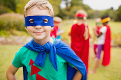 Little boy wearing superhero costume posing for camera. In the park Stock Images