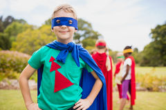 Little boy wearing superhero costume posing for camera. In the park Stock Photography