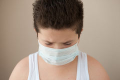 Little boy wearing surgical mask Royalty Free Stock Image