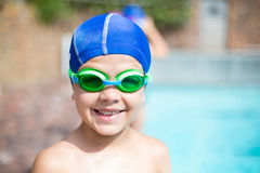 Little boy wearing swimming goggle and cap Royalty Free Stock Image