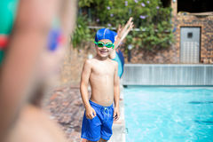 Little boy wearing swimming goggle at poolside Royalty Free Stock Images