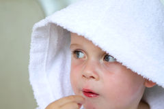 Little boy wearing a white bath robe Stock Images