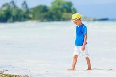 Boy having fun on tropical ocean beach. Kid during family sea vacation. Royalty Free Stock Photo