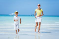 Boy with his sister having fun on tropical ocean beach. Kid during family sea vacation. Royalty Free Stock Photo