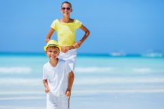 Boy with his sister having fun on tropical ocean beach. Kid during family sea vacation. Stock Images