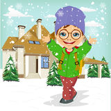 Little boy wearing winter clothes playing with snow Royalty Free Stock Photos