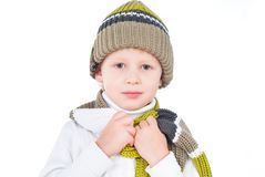 Little boy wearing winter outfit isolated on white Royalty Free Stock Images