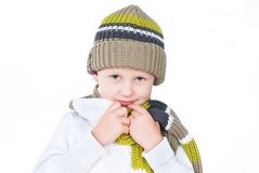 Little boy wearing winter outfit isolated on white Stock Image