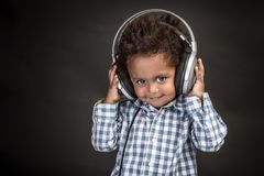 Little Boy Wears Big Headphones Stock Photography