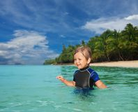 Little boy in the wetsuit Royalty Free Stock Photo