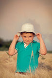 Little boy in wheat field Stock Images