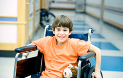 Little Boy in Wheelchair Stock Images