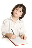 The little  boy which drawing. The little boy which drawing of pencil in notebook Stock Photo
