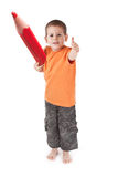 Little boy whit large pencil Stock Photography