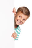 Little boy with white blank. Portrait of happy little boy with white blank isolated on white background Royalty Free Stock Photography