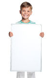 Little boy with white blank Stock Images