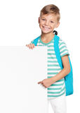 Little boy with white blank. Portrait of happy schoolboy with white blank isolated on white background. Child holding empty placard and looking at camera stock photography