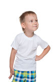 Little boy in a white shirt imagines Stock Photos