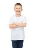 Little boy in white t-shirt with arms crossed. Happiness, childhood and people concept - smiling little boy in white t-shirt with his arms crossed Stock Images