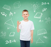 Little boy in white t-shirt making ok gesture Royalty Free Stock Image