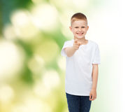 Little boy in white t-shirt pointing his finger Stock Image