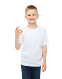 Little boy in white t-shirt showing ok gesture Stock Image