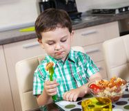 Little boy who does not eat his food with lust. Little boy who does not eat his food stock photo