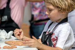 Little boy who paints ceramic funny objects stock photography