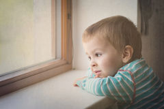 Little boy on the window Royalty Free Stock Images