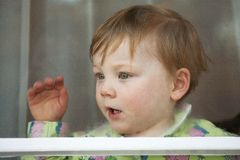 Little Boy in Window Royalty Free Stock Photos