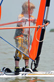 Little boy windsurfing Stock Photography