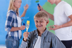 Little boy winkling and parents arguing Stock Photos