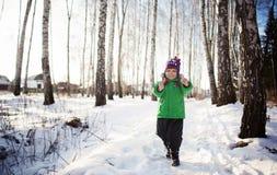 little boy in winter forest Stock Photo
