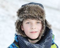 little boy in winter a fur hat in winter Royalty Free Stock Images