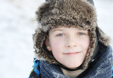 Little boy in winter a fur hat in winter Royalty Free Stock Photos