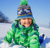 Little boy in winter park Royalty Free Stock Photos