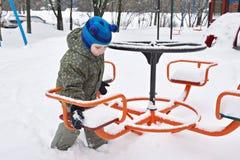 Little boy on winter playground Stock Image