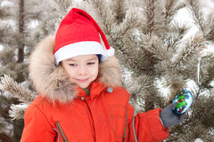 Little boy at the winter walk is decorated with Royalty Free Stock Photos