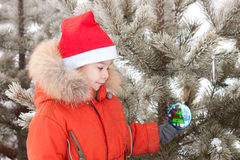 Little boy at the winter walk is decorated with Stock Images