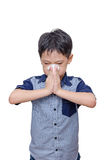Little boy wipes his nose by tissue paper Stock Image