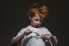 Little boy with wires stock photography