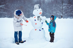 Little Boy With His Mother Painting A Snowman Royalty Free Stock Photo