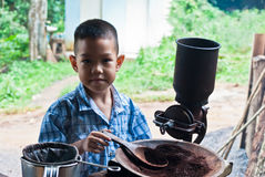 Little boy withVintage coffee mill grinder Royalty Free Stock Image