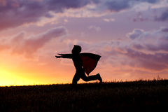 Little boy wonder at sunset. Royalty Free Stock Images